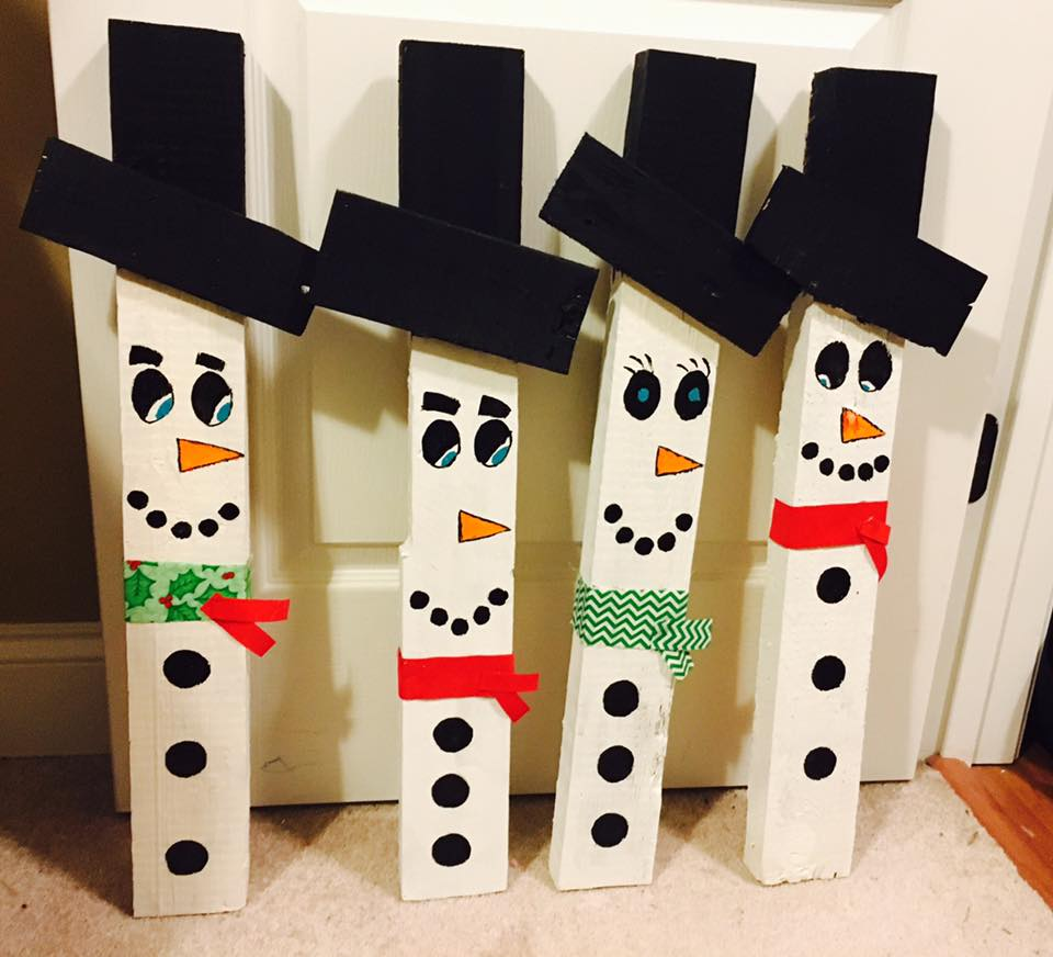 Paint a face on a sliced log, stack it, wrap fabric around it and you've got the cutest Log snowman (MarketingMomx4).
